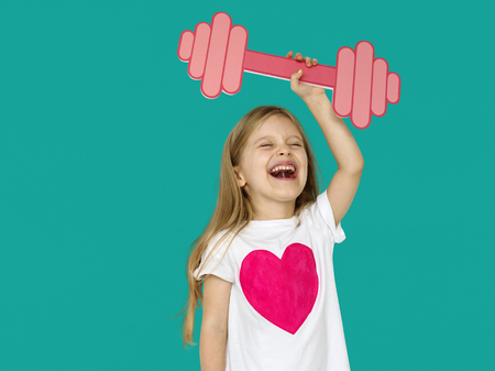 dumb bells: Little Girl Lifting Prapercraft Dumb Bells Stock Photo
