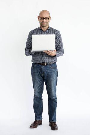 Mature guy using laptop full body portrait