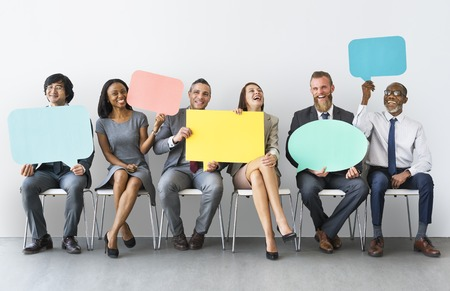 Business Team Speech Bubble Holding Concept Imagens