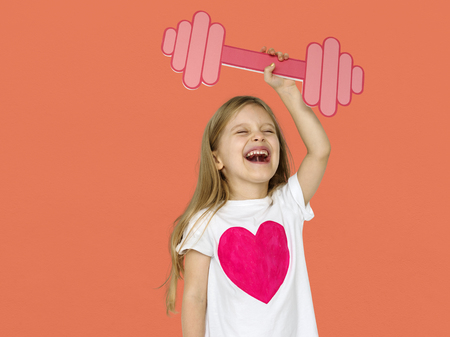 Little Girl Lifting Prapercraft Dumb Bells Stock Photo