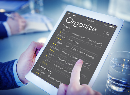 agenda browse: Business people checking appointment on personal organizer schedule Stock Photo
