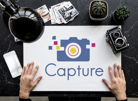 media gadget: Camera is a device for capture a memory. Stock Photo