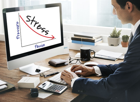 Businessman at work with stress concept Stock Photo