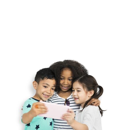 Little kids studio looking together with tablet Stock Photo