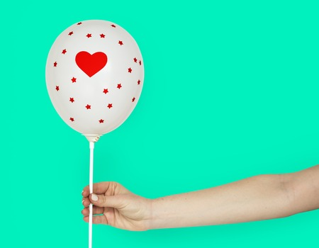 Hands Holding Balloon Heart Decoration Stock Photo