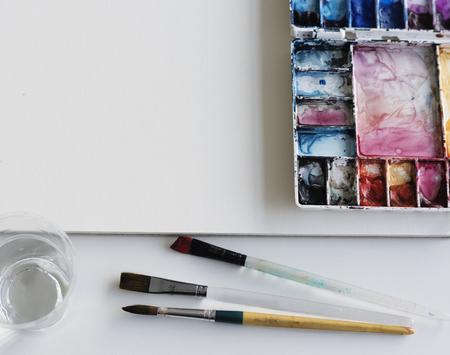 Painting Palette Sketchbook Paper Brushes White Table Stock Photo - 76519365