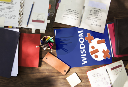 case studies: Aerial view of mathematics solution lessons on wooden table