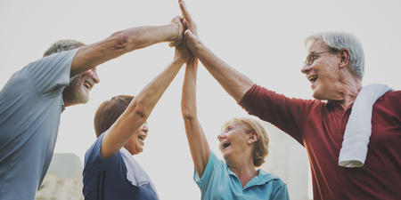 vigor: Senior Adult Teamwork Hands Together Stock Photo