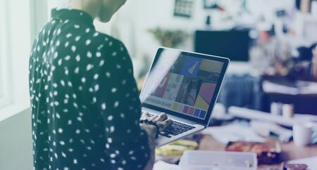 messy clothes: Fashion designer tailor made with laptop Stock Photo