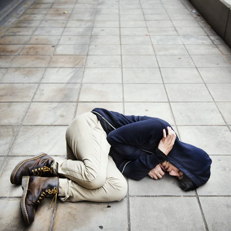 Young man homeless sleep on the street Stock Photo - 76700305