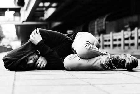 Young man homeless sleep on the street Stock Photo - 76700842