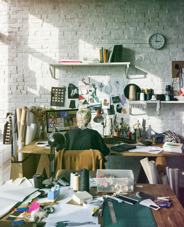 messy clothes: Fashion designer working on her workspace