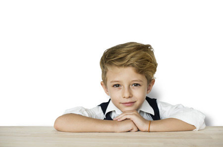 Boy leaning on a table Stock Photo - 112457529