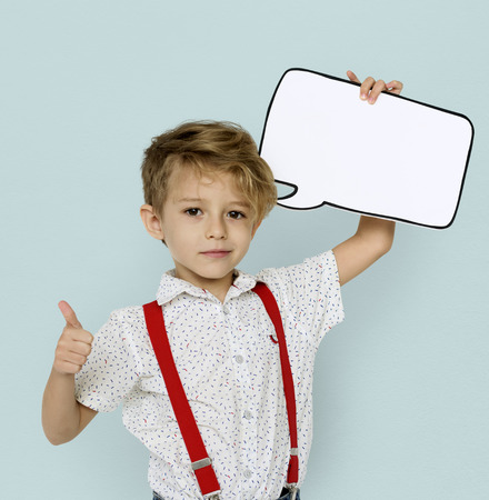 Little Boy Holding Papercraft Chat Bubble