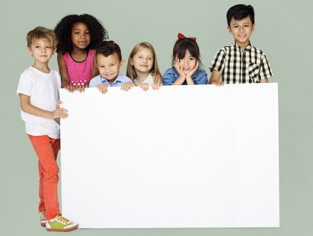 Group of Kids Showing Copyspace Board Reklamní fotografie