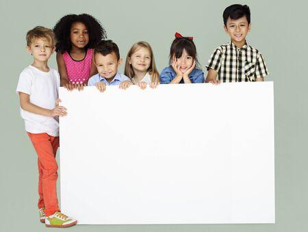Group of Kids Showing Copyspace Board Imagens