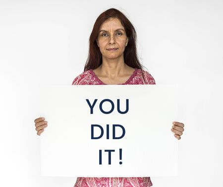 Indian woman holding a word you did it