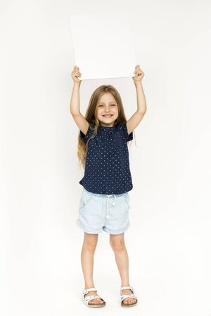 Studio shoot with kid holding blank paper