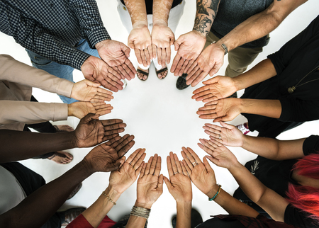 DIverse hands are together in a circle shape