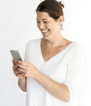 Adult Woman Smile Use Phone Studio Portrait Stock Photo