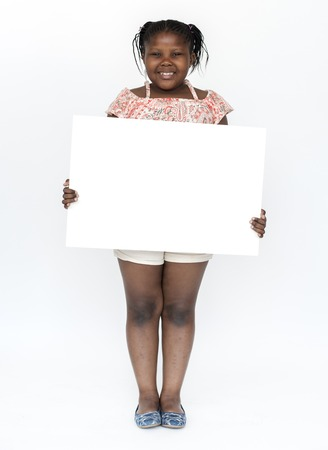 African kid holding empty board for communication advertising