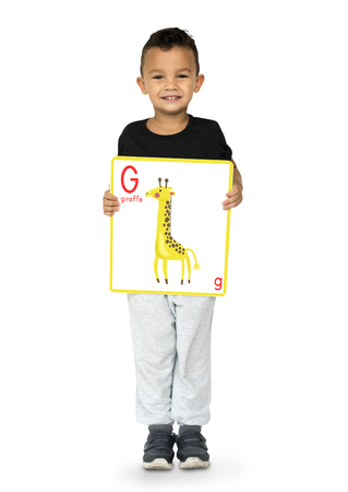 Happiness little boy smiling and holding alphabet animal placard
