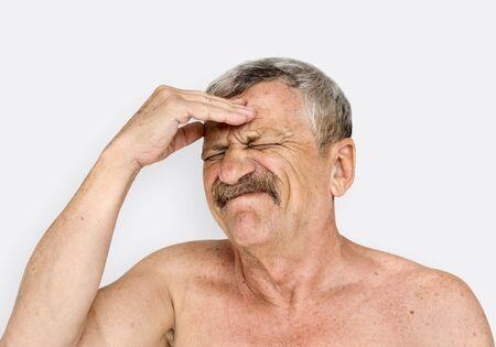 Man doing shirtless close up photoshoot in studio