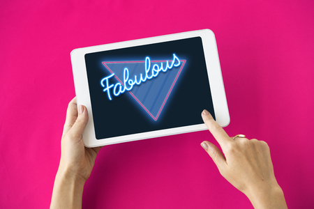 using tablet: Fabulous Awesome Amazing Triangle Graphic Stock Photo