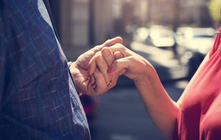 Mature people romantic holding hands Stock Photo