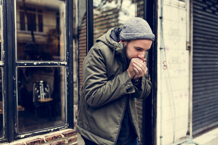 Guy Blowing his Hands in Cold Outdoor