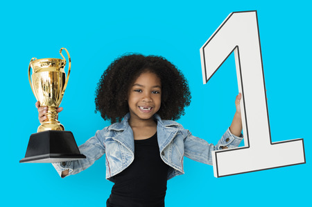 Little Girl Holding Trophy Happy Stock Photo