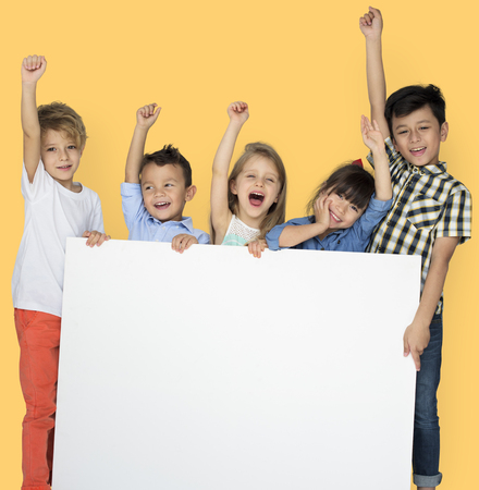 Group of Kids Showing Copyspace Board Stock Photo