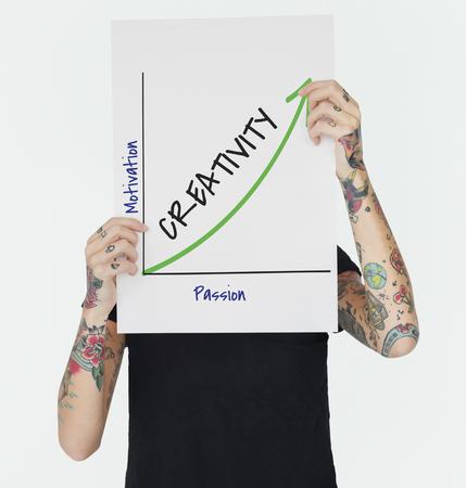 hand holding paper: Enjoy Success Growth Graph Development Stock Photo