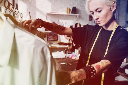 Fashion designer measuring size for tailor made