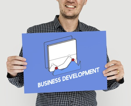 Man showing a placard with business development concept