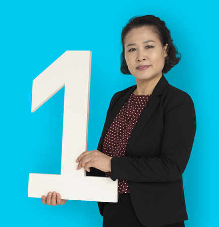 Asian businesswoman holding number 1
