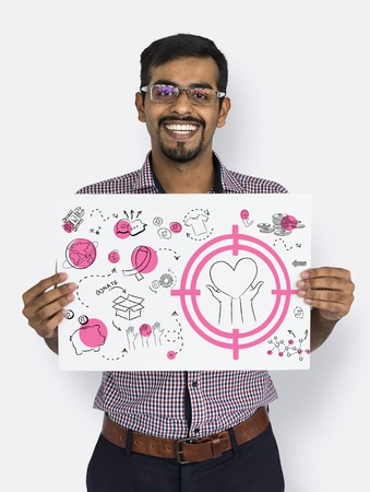 Cheerful man showing a placard with donation concept Reklamní fotografie