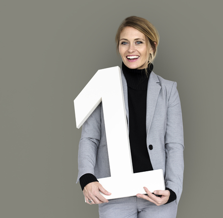 Businesswoman holding number 1