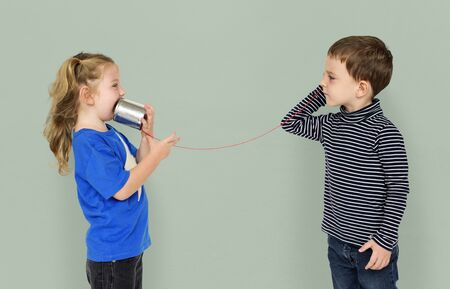 Little Kids Using String Phone Adorable Cute Stock Photo
