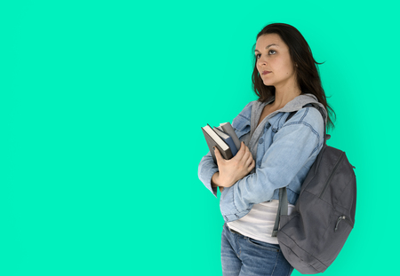 Girl student is carrying books and backpack