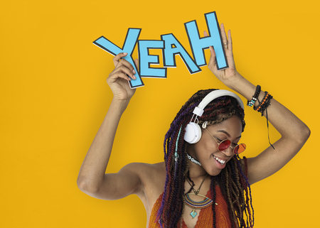 African Descent Female Yeah Headphones Stock Photo