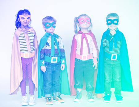 Superheroes kids standing on the white background
