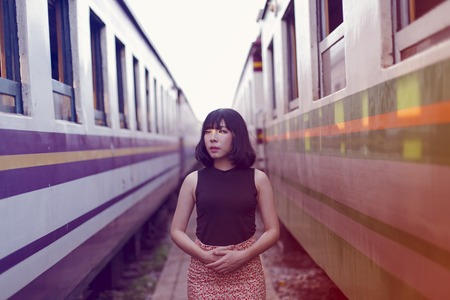 Asian ethnicity girl is on a train. Stock Photo