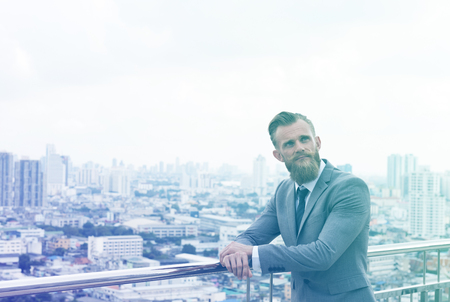 Professional businessman posing on footbridge cityscape