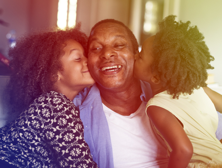 smooch: Photo Gradient Style with African Descent Family House Home Resting Living Stock Photo