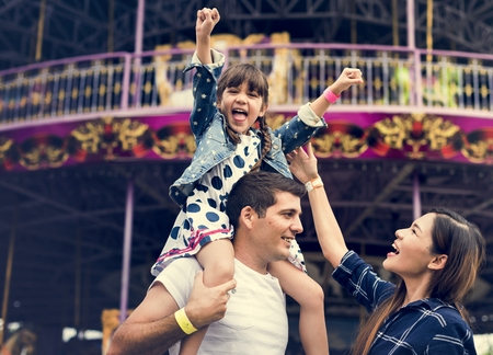 Family Holiday Vacation Amusement Park Togetherness Banque d'images