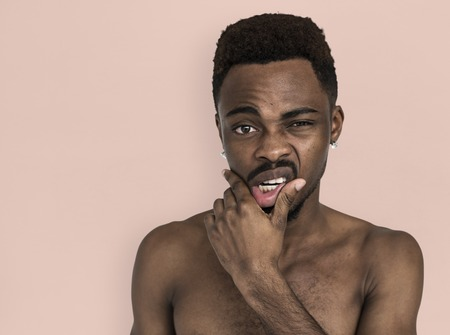 African Man Bare Chest Touching Mouth Portrait Stock Photo