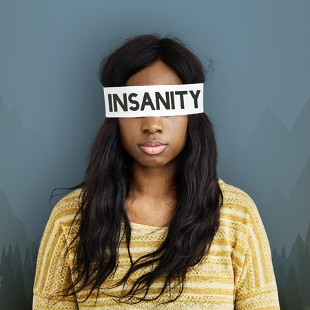 Blindfolded woman with insanity concept Stock Photo