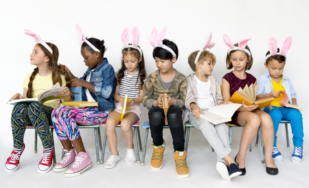Group of children in a row with bunny head band.