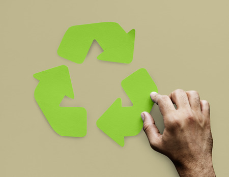 hand holding paper: Arrow Process Connection Recycle Step